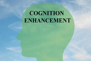 "Render illustration of ""COGNITION ENHANCEMENT"" script on head silhouette with cloudy sky as a background. Human mind concept."