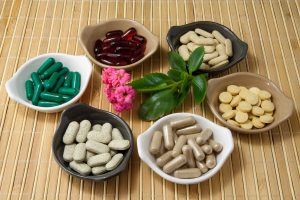 Different Herbal Pills: Echinacea, seabuckthorn, Spirulina, Propolis, Ginseng, sweetwood . Nutritional Supplements.