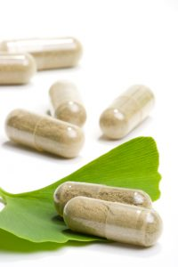 Closeup of supplement pills and leaves best suited for aged people alternative medicine ads